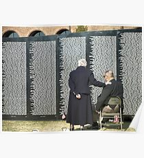 Couple at the traveling Vietnam wall Poster