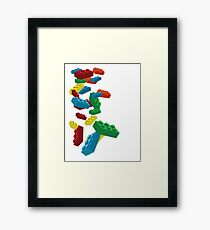 Falling Legos Framed Print