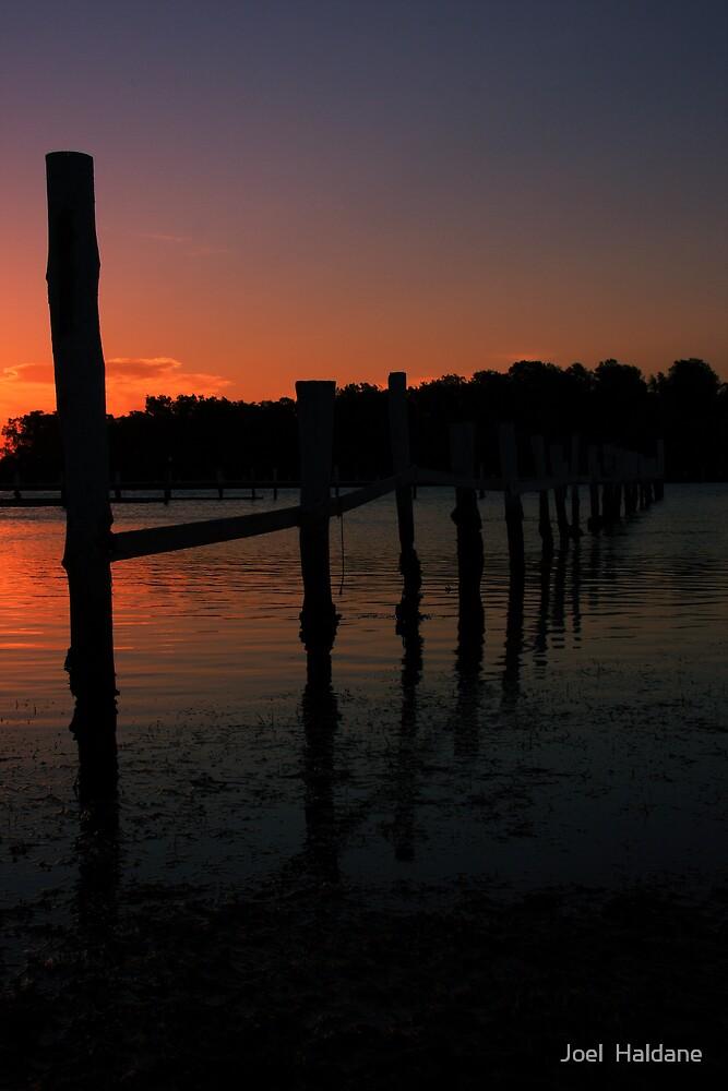 Sunset Poles by Joel  Haldane