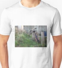 Abandoned  in overgrowing  grass T-Shirt