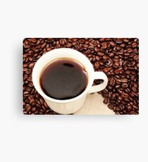 Coffee beans with a white cup of coffee Canvas Print