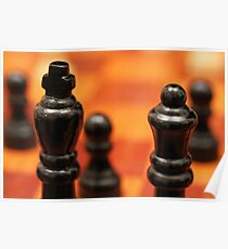 Chess pieces close up on a wooden board Poster