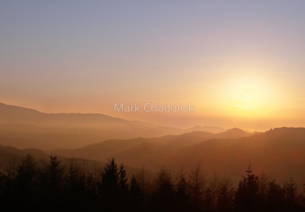 sunset over welsh mountains by Mark Chadwick
