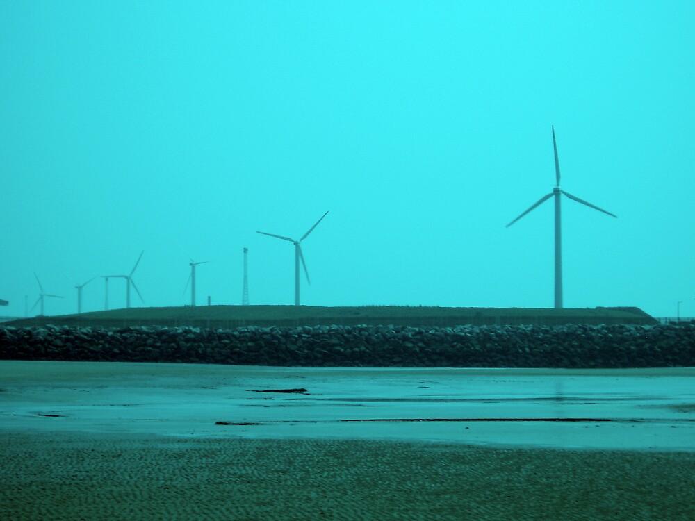 Windmills on a Beach by Hippyman
