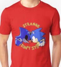 STRANGE, ISN'T IT?! Unisex T-Shirt