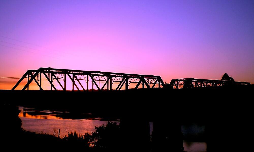 Railway Bridge at Dusk by ticktock7772003