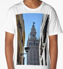 Buildings facades on narrow street with tower in Sevilla, Spain Long T-Shirt