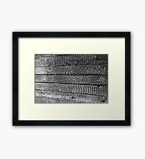 Charred wooden wall after fire arson Framed Print