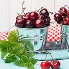 Cherries in blue wooden table by homydesign