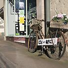 The bike outside the coffee shop in Painswick, Stroud, Gloucestershire by Jeff  Wilson