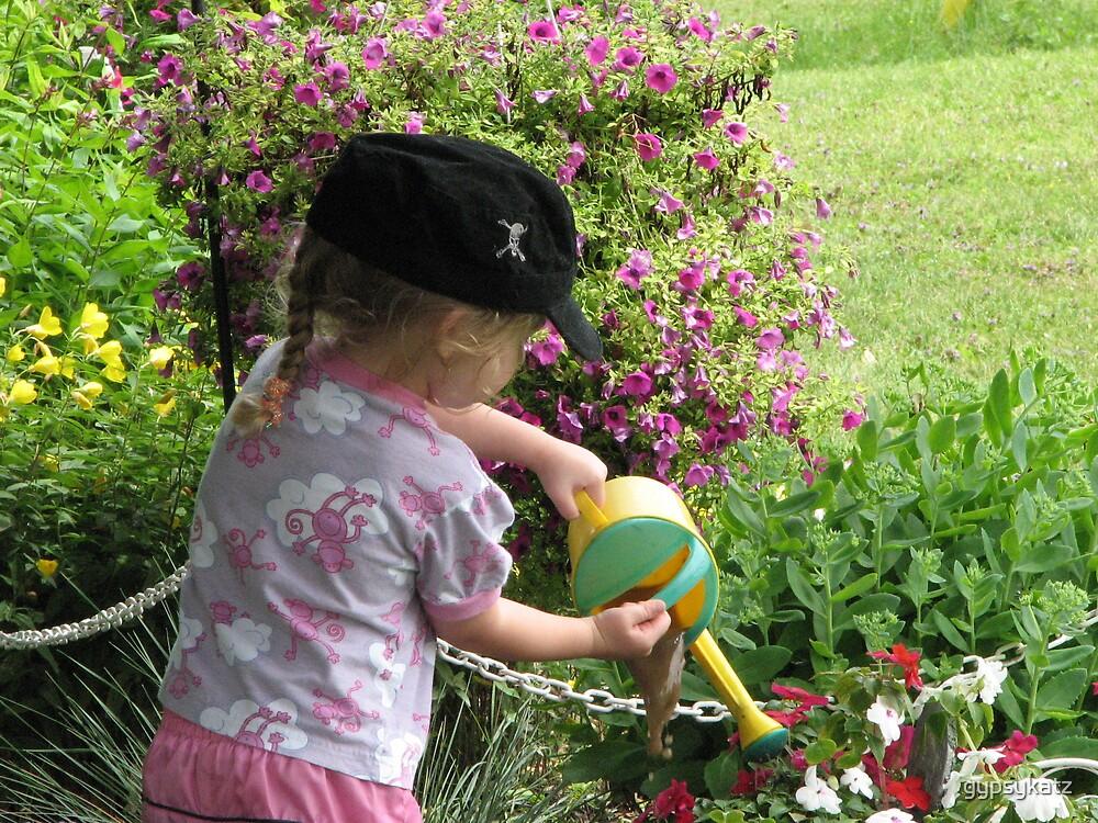 watering the flowers by gypsykatz