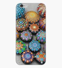 Mandala painted stones on sand. iPhone Case