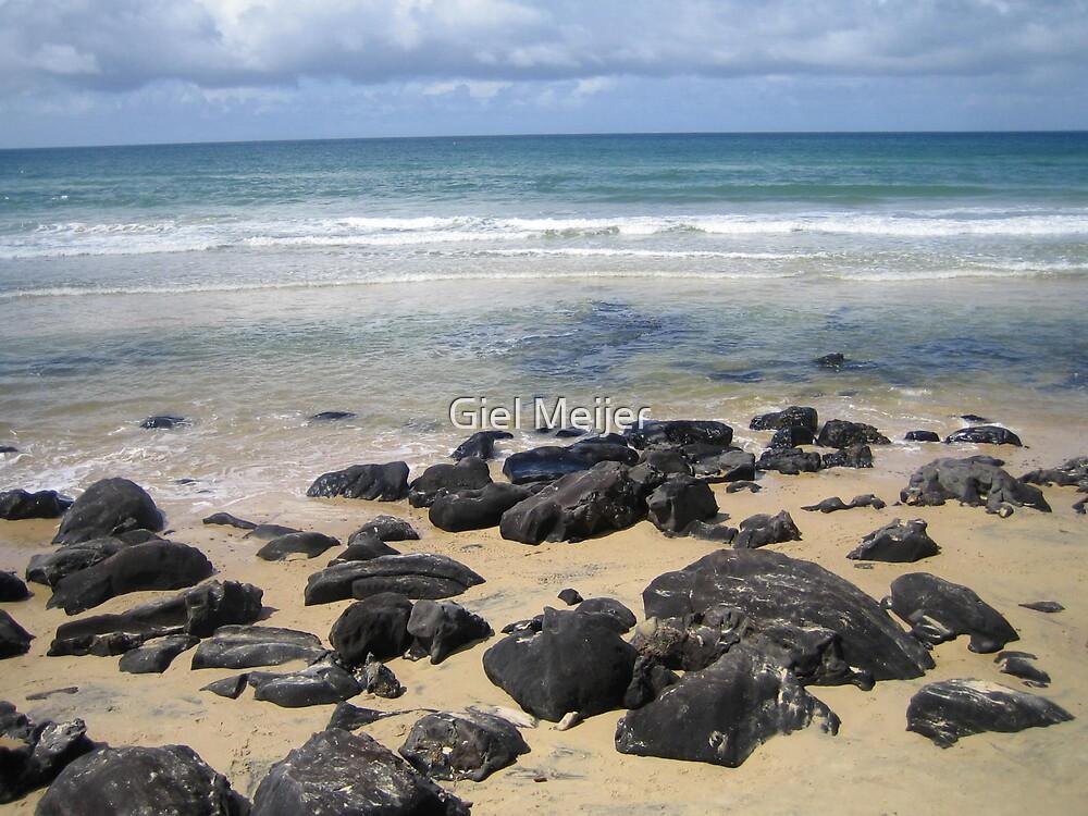 Rocks on the beach by Giel Meijer
