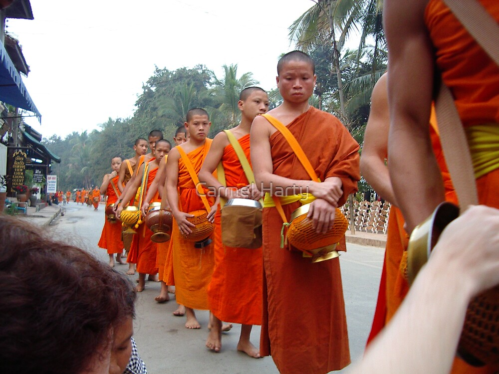 Lao Monks lining up for food by Carmel Harty