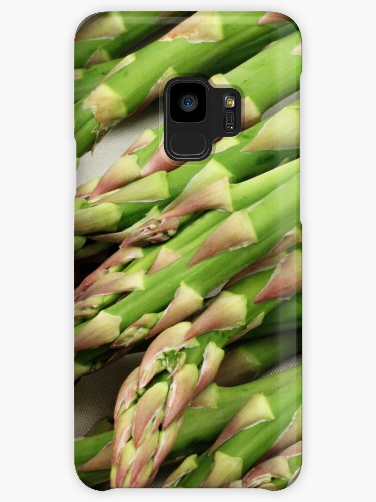 A close up image of fresh asparagus by tethysimaging