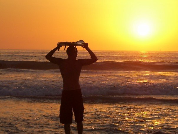 Surfer at Sunset by caitlin444