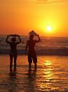 Surfers at Sunset by caitlin444