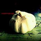 Garlic On A Table  by Evita