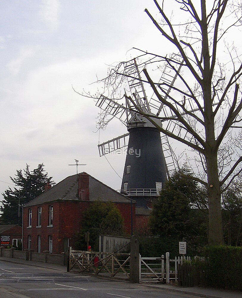 Railway crossing and windmill by shakey
