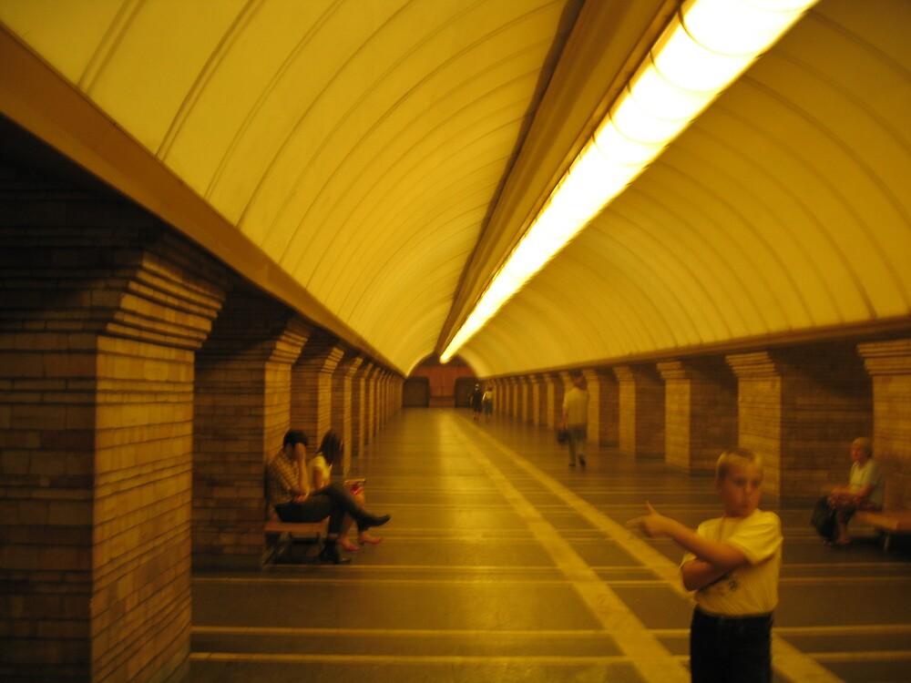 Boy stretching at a metro station in Kiev by BrendanBurns