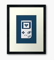 Portable console Framed Print