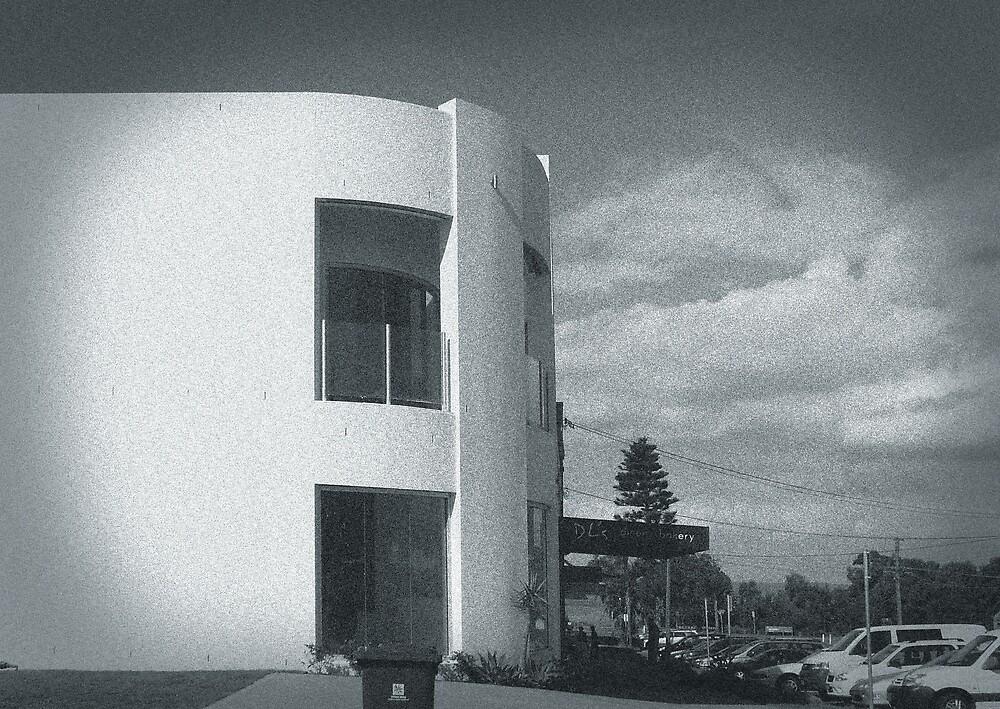 white building by Adam Pearson