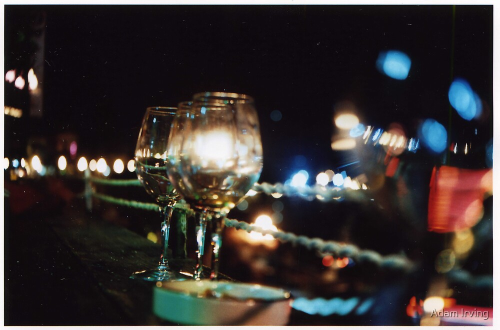 Wine Glasses at night by Adam Irving
