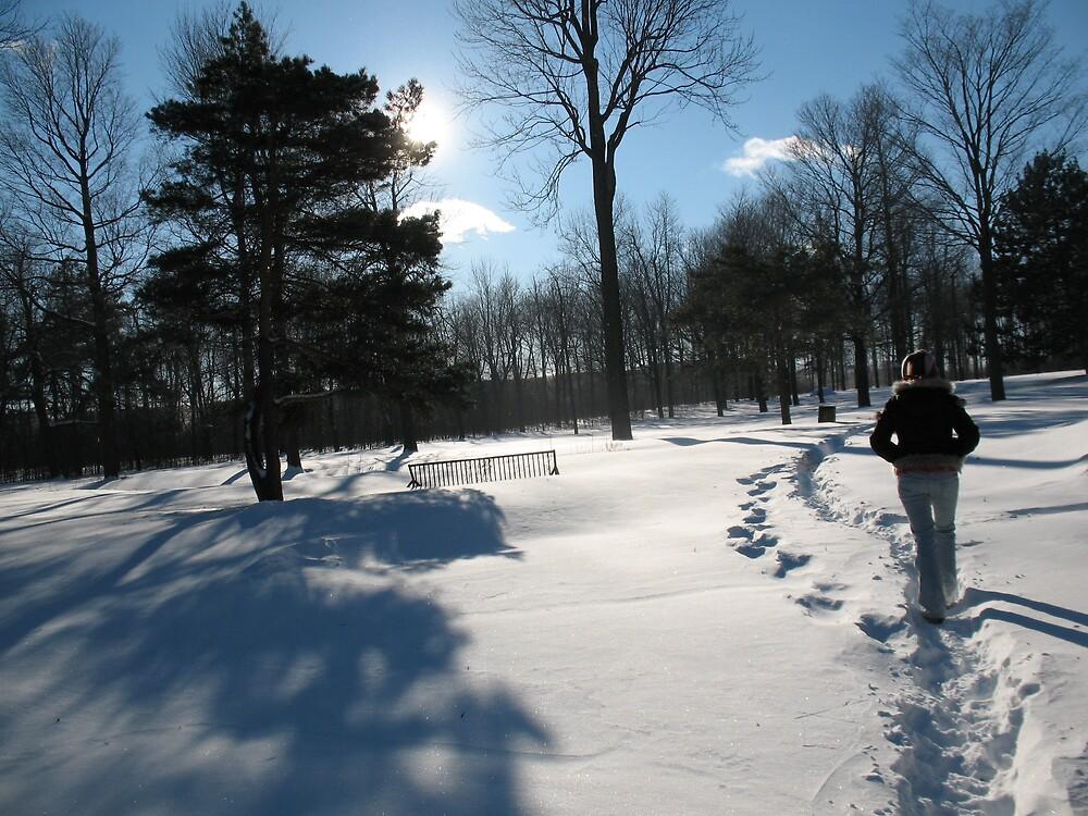 Girl Walking in Snow in Forest by Caroline Ronalds