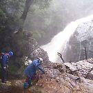 trying not to slip on the wet moss-covered rocks at Stitt Falls, Rosebery by gaylene