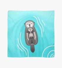 Mutter-und Welpen-Seeotter - Mutter, die Baby-Otter hält Tuch