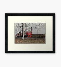 Commuter train countryside Framed Print