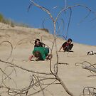 rough and tumble games in the sand - at Ocean Beach, Strahan by gaylene