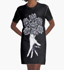 Hand with lotuses on black T-Shirt Kleid