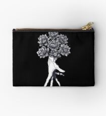 Hand with lotuses on black Studio Pouch