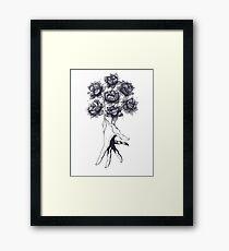 Hand with lotuses on black Framed Print