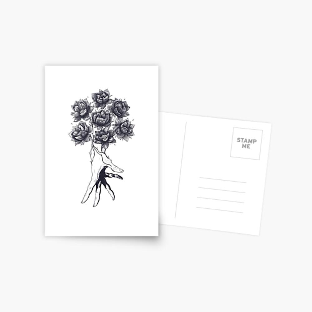 Hand with lotuses on black Postkarte