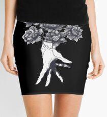 Hand with lotuses on black Mini Skirt