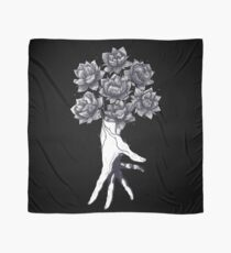 Hand with lotuses on black Scarf