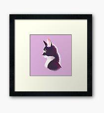 Sly cat in profile Framed Print