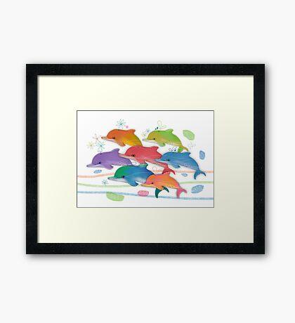 A Rainbow of Dolphins Framed Print