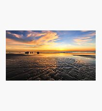 Four wheel drives on beach at sunset Photographic Print