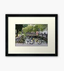 Bicycles by the river Framed Print