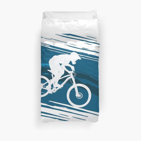 Silhouette of a cyclist riding a mountain bike Duvet Cover