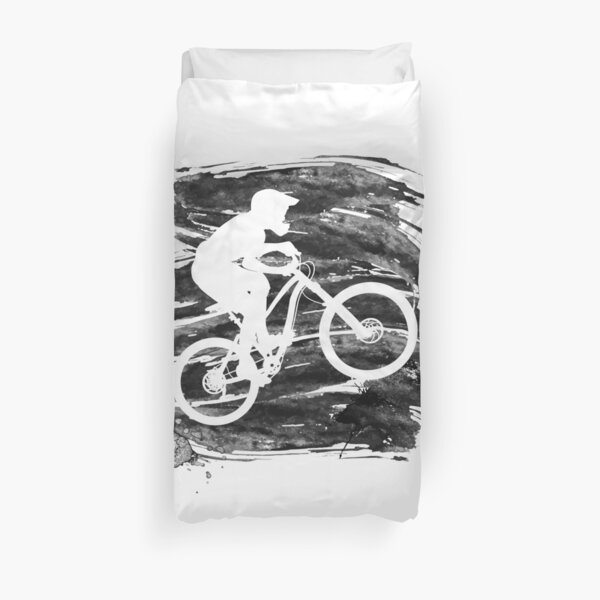 Silhouette of a biker descending on a mountain bike on a slope - 3 Duvet Cover