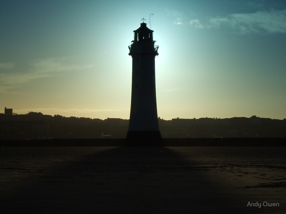 Sunset behind Lighthouse by Andy Owen