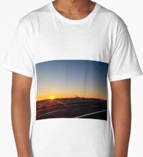 sun goes down behind an industry Long T-Shirt