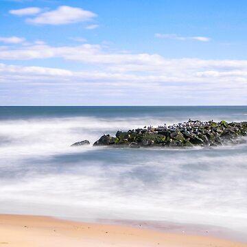Rocks off of Beach Shoreline. by travispowers