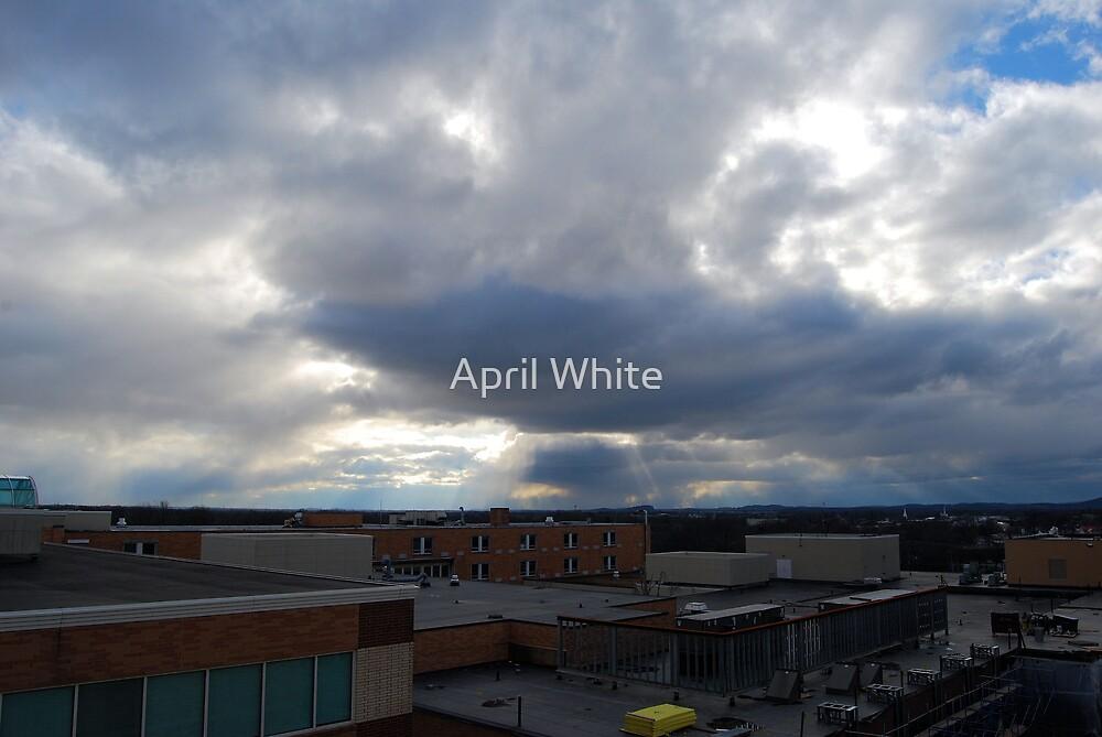 Sun Peeking Through Rain Clouds by April White