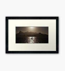 Sailing boat backlit in Rio de Janeiro Framed Print