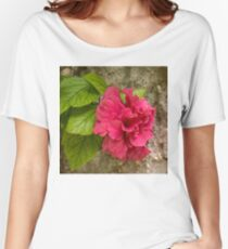 Rough and Soft - Satiny Pink Hibiscus Against Coarse Stony Cliff Women's Relaxed Fit T-Shirt